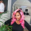 DJ Cuppy Looks Peng in Pink Hair.