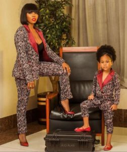 mother and daughter in matching outfits